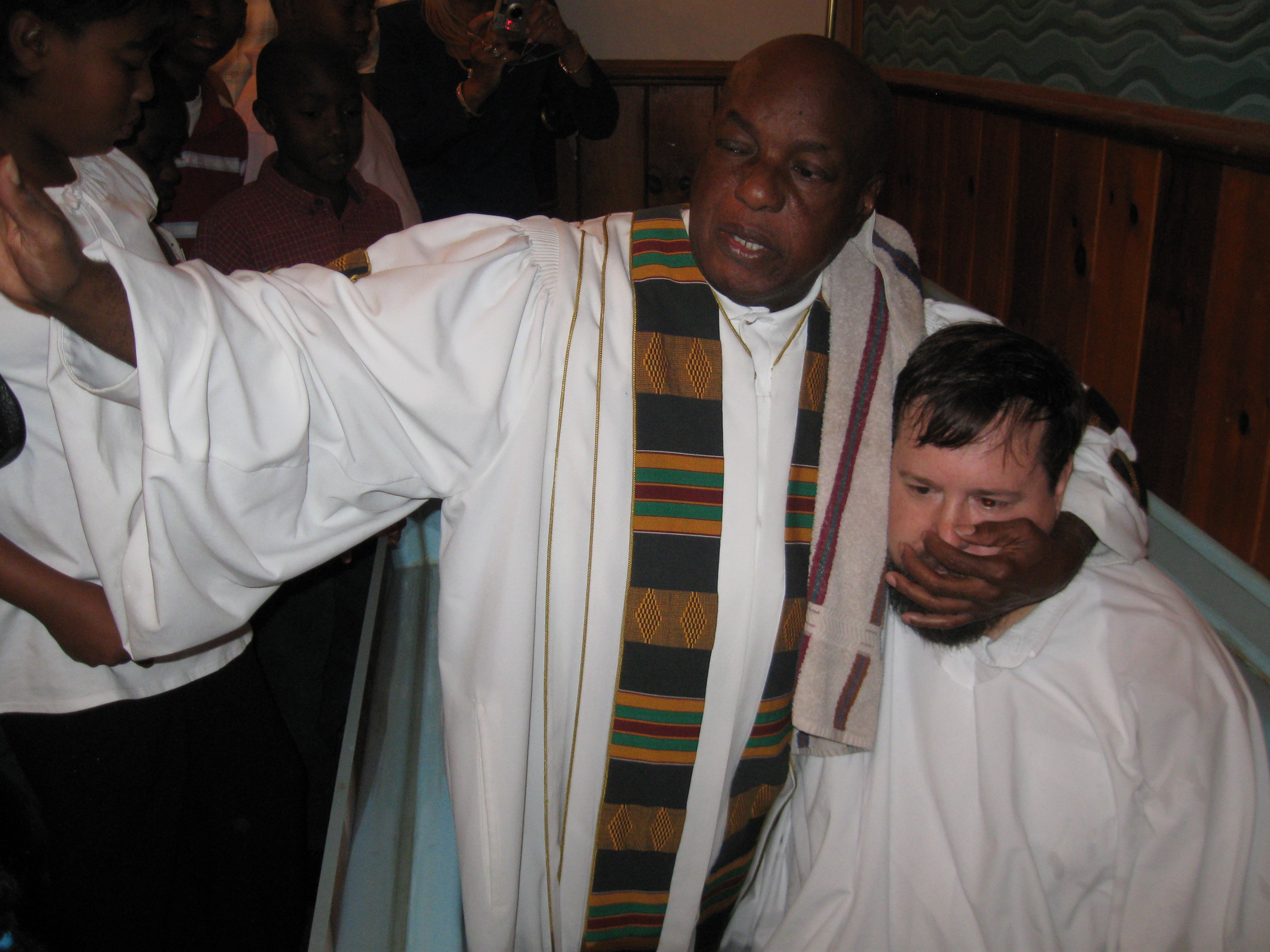 PASTOR OLIVER DORSEY PERFORMING BAPTISM IN THE NAME OF THE FATHER, SON AND HOLY SPIRIT (PHOTO BY PASTOR DAVIS)